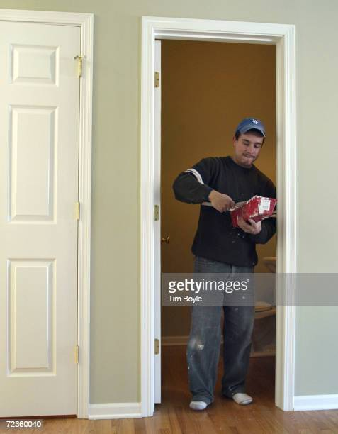 Cliserio Torres mixes plaster as he exits a firstfloor bathroom through an oldertype interior doorway of a new home under construction February 8...