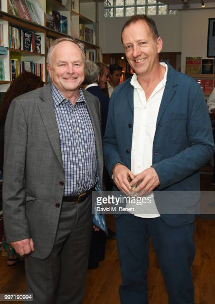 Clive Anderson and Tom Baldwin attend the launch of new book 'Ctrl Alt Delete' by Tom Baldwin at Ink 84 on July 12 2018 in London England