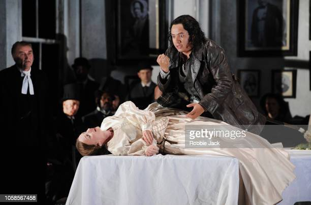 Clive Bayley as Raimondo BidebentSarah Tynan as Lucia and Eleazar Rodriguez as Edgardo with artists of the company in English National Opera's...