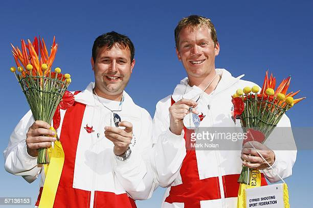 Clive Bramley and Richard Brickell pose for photos after winning silver during the Mens Skeet Pairs clay target shooting at the Melbourne Gun Club...