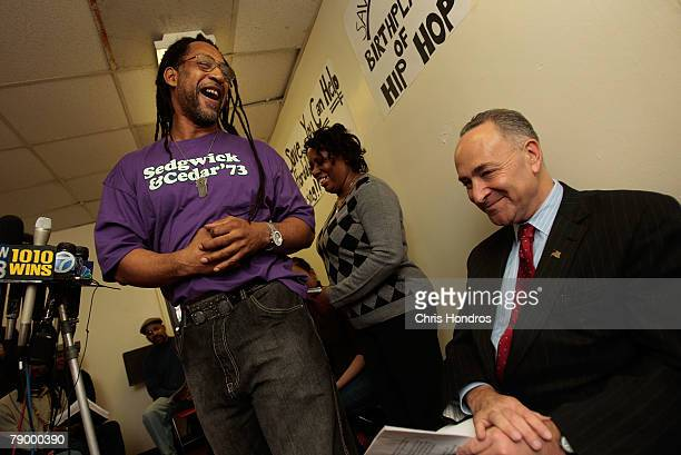 Clive Campbell also konwn as DJ Kool Herc smiles at Sen Charles Schumer during a press conference about the fate of 1520 Sedgwick Avenue a building...