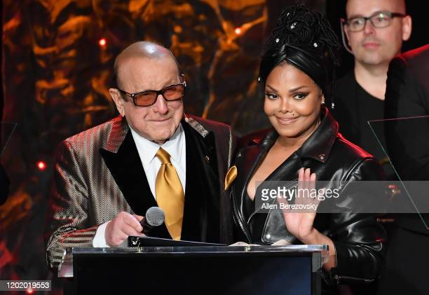 Clive Davis and Janet Jackson speak onstage during the PreGRAMMY Gala and GRAMMY Salute to Industry Icons Honoring Sean Diddy Combs on January 25...