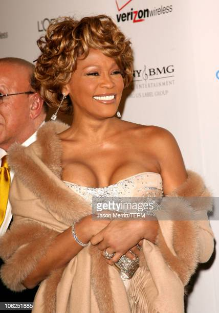 Clive Davis and Whitney Houston during 2007 Clive Davis PreGRAMMY Awards Party Arrivals at Beverly Hilton Hotel in Beverly Hills California United...