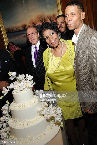 Clive Davis Aretha Franklin and son Kecalf Franklin attend Aretha Franklin's 72nd Birthday Celebration at The RitzCarlton Hotel on March 22 2014 in...