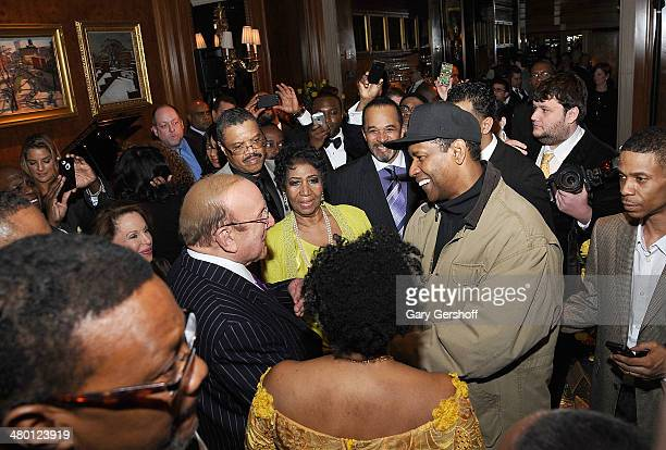 Clive Davis Aretha Franklin Denzel Washington and Kecalf attend Aretha Franklin's 72nd Birthday Celebration at The RitzCarlton Hotel on March 22 2014...