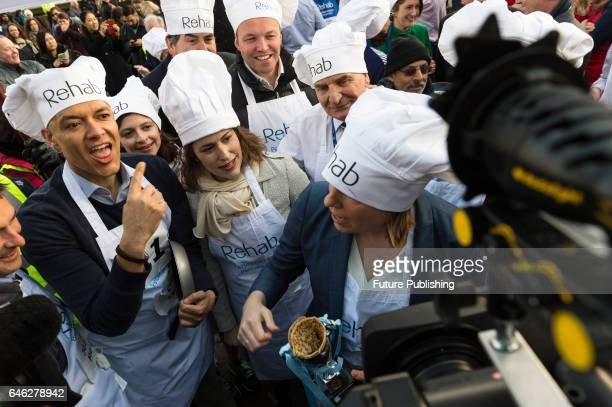 Clive Lewis MP celebrates victory in the 20th Parliamentary Pancake Race on Shrove Tuesday also known as Pancake Day or Fat Tuesday in Victoria Tower...