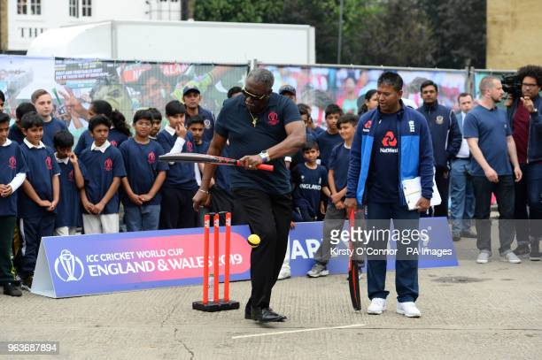 Clive Lloyd bats as he takes part in a cricket game for school children during the 2019 Cricket World Cup countdown event at 93 Feet East London