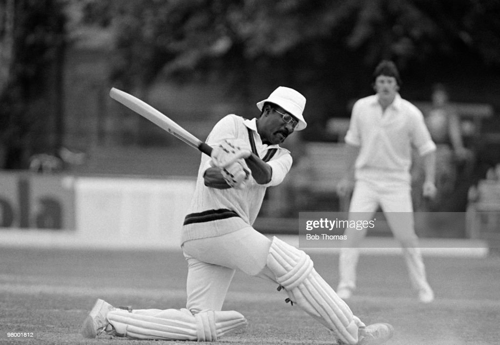 Clive Lloyd batting for Lancashire during his innings of 102 against Northamptonshire in the County Championship match at the County Ground in Northampton, 13th July 1979. In the background, the Northamptonshire fielder is Jim Griffiths. Lancashire won by 72 runs.