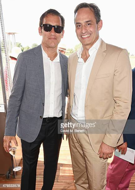 Clive Owen and Andre Konsbruck Director of Audi UK attend the Audi Polo Challenge 2015 at Cambridge County Polo Club on July 3 2015 in Cambridge...