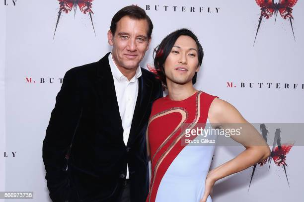 Clive Owen and Jin Ha pose at the Opening Night After Party for 'M Butterfly' on Broadway at Red Eye Grille on October 26 2017 in New York City