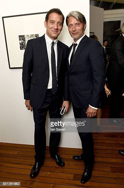 Clive Owen and Mads Mikklesen attend as Charles Finch hosts the 8th Annual Filmmakers Dinner with JaegerLeCoultre at Hotel du CapEdenRoc on May 13...