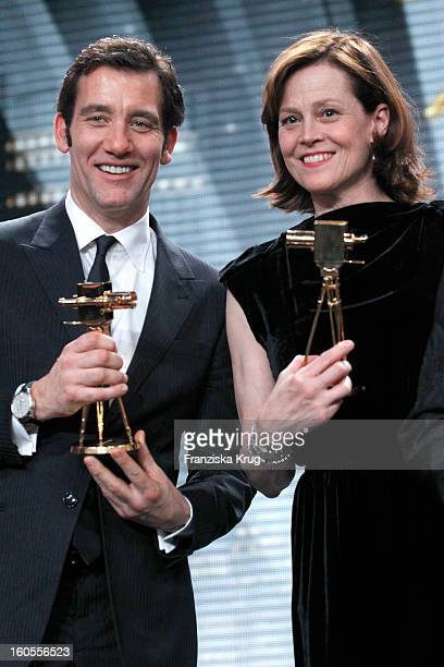 Clive Owen and Sigourney Weaver present their awards at 'Goldene Kamera 2013' at Axel Springer Haus on February 2 2013 in Berlin Germany