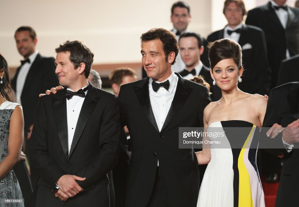 Clive Owen (C), director Guillaume Canet and actress Marion Cotillard leave the Premiere of 'Blood Ties' during the 66th Annual Cannes Film Festival at the Palais des Festivals on May 20, 2013 in Cannes, France.
