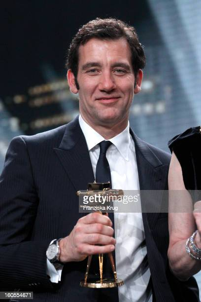 Clive Owen presents his award at 'Goldene Kamera 2013' at Axel Springer Haus on February 2 2013 in Berlin Germany