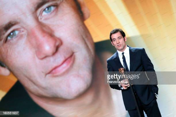 Clive Owen receives an award at 'Goldene Kamera 2013' at Axel Springer Haus on February 2 2013 in Berlin Germany