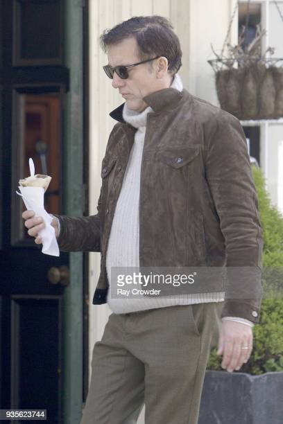 Clive Owen seen buying a crepe from a stall in Hampstead on March 21 2018 in London England