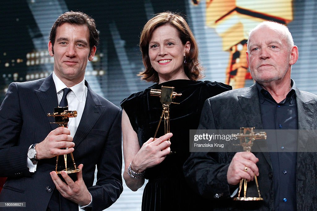 Clive Owen, Sigourney Weaver and Joe Cocker present their awards at 'Goldene Kamera 2013' at Axel Springer Haus on February 2, 2013 in Berlin, Germany.