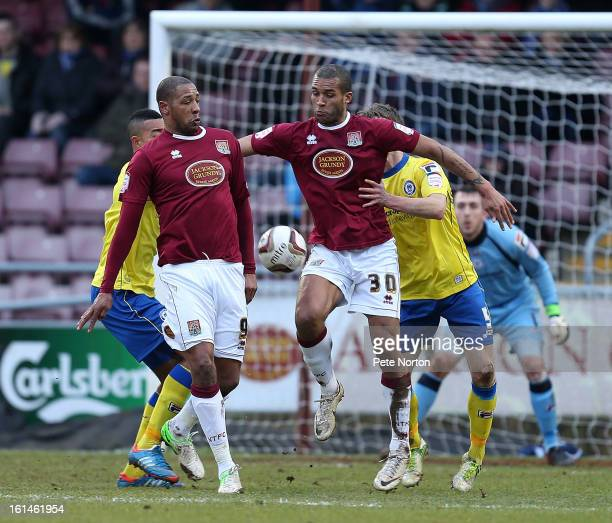 Clive Platt and Clarke Carlisle of Northampton Town both look to control the ball during the npower League Two match between Northampton Town and...