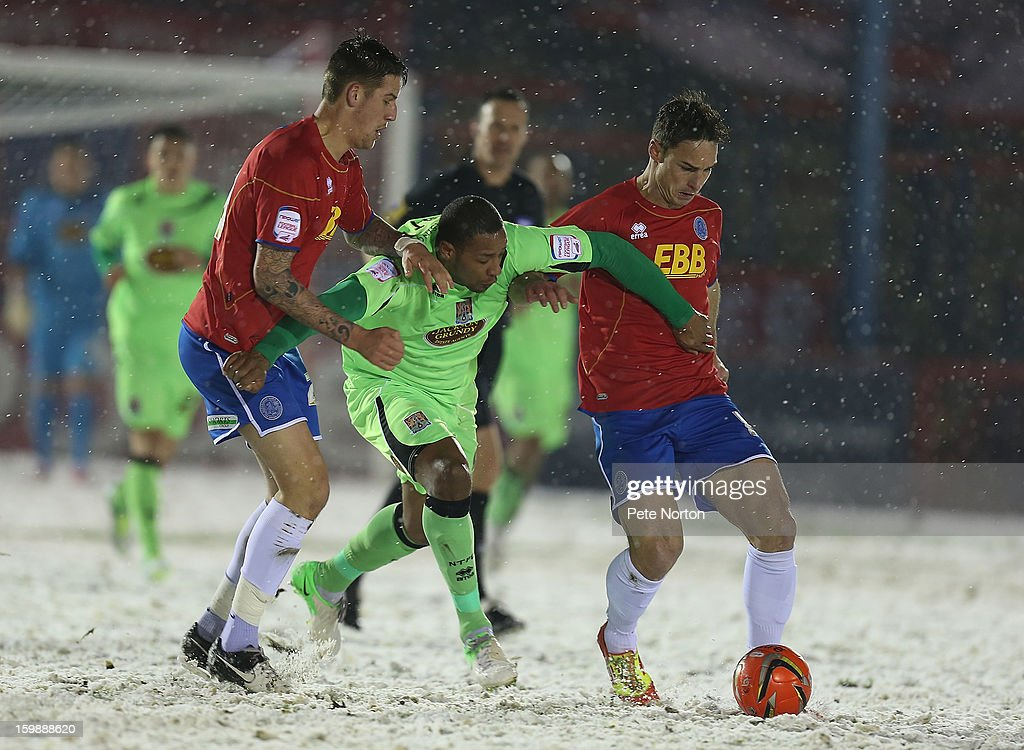 Clive Platt of Northampton Town attempts to move between Oliver Risser (r) and Sonny Bradley of Aldershot Town during the npower League Two match between Aldershot Town and Northampton Town at the EEB Stadium on January 22, 2013 in Aldershot, England.
