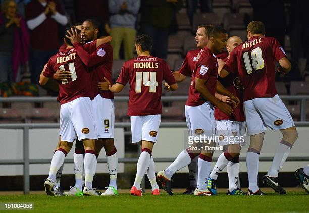 Clive Platt of Northampton Town celebrates with teammates after scoring during the Capital One Cup second round match between Northampton Town and...