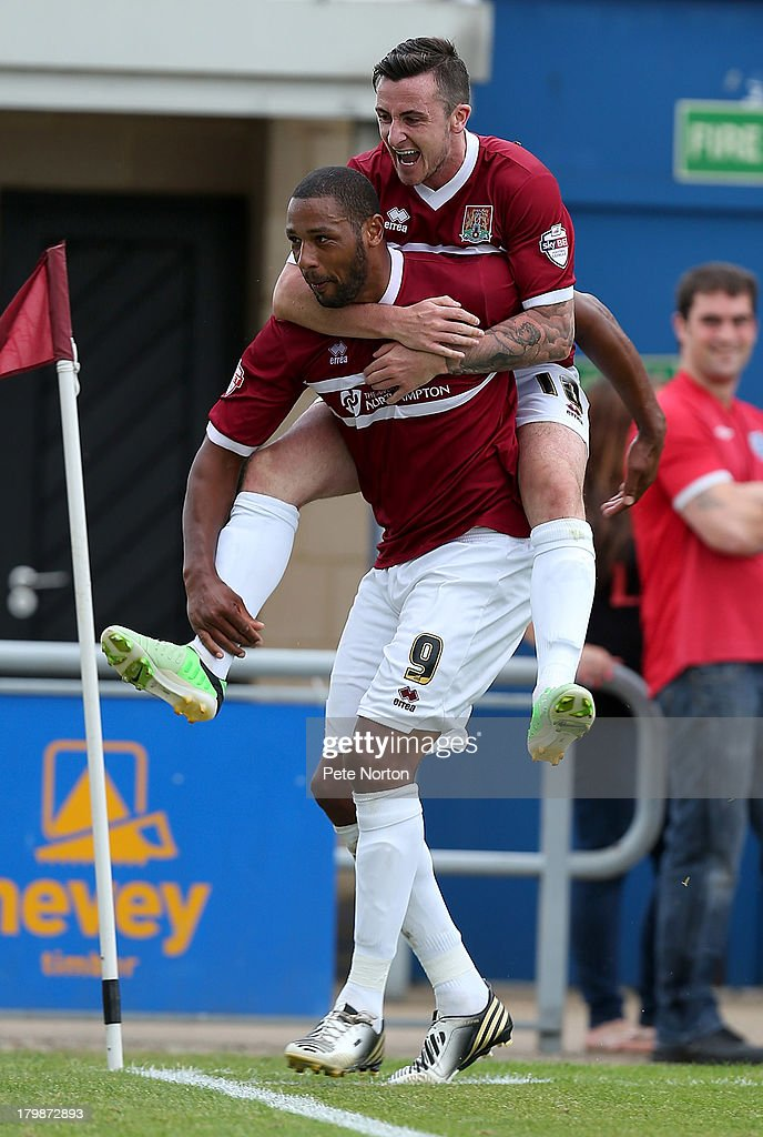 Clive Platt of Northampton Town is congratulated by team mate Roy O'Donovan after scoring his sides goal during the Sky Bet League Two match between Northampton Town and Scunthorpe United at Sixfields Stadium on September 7, 2013 in Northampton, England.
