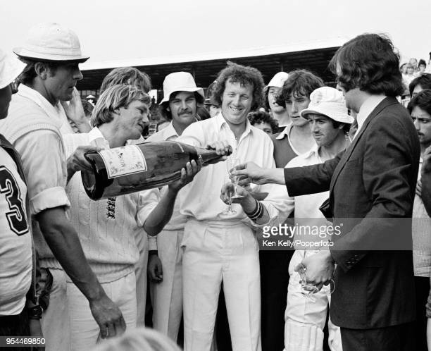 Clive Radley of England pours champagne for teammate Graham Roope after the 3rd Test match between England and Pakistan at Headingley Leeds 4th July...