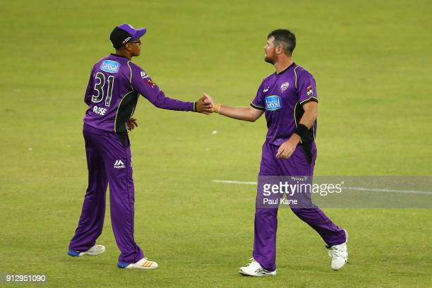 Clive Rose and Dan Christian of the Hurricanes celebrate the wicket of Matthew Kelly of the Scorchers during the Big Bash League Semi Final match...