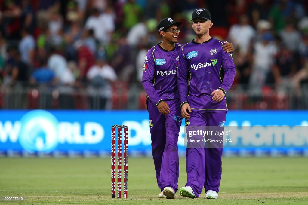 Clive Rose and D'Arcy Short of the Hurricanes celebrate victory during the Big Bash League match between the Sydney Thunder and the Hobart Hurricanes at Spotless Stadium on January 1, 2018 in Sydney, Australia.