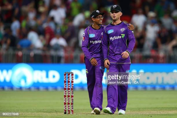 Clive Rose and D'Arcy Short of the Hurricanes celebrate victory during the Big Bash League match between the Sydney Thunder and the Hobart Hurricanes...