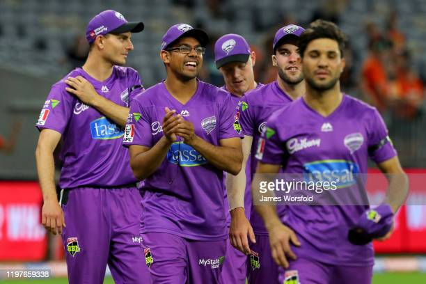 Clive Rose of the Hobart Hurricanes is all smiles after their win as he walks off the field during the Big Bash League match between the Perth...