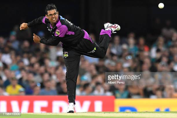 Clive Rose of the Hurricanes bowls during the Big Bash League match between the Brisbane Heat and the Hobart Hurricanes at the Gabba on January 09,...