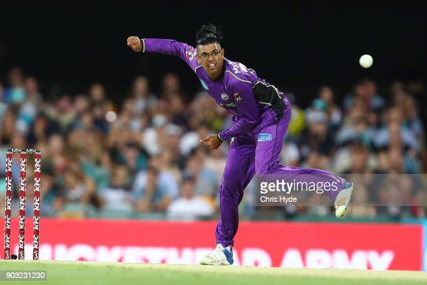 Clive Rose of the Hurricanes bowls during the Big Bash League match between the Brisbane Heat and the Hobart Hurricanes at The Gabba on January 10...