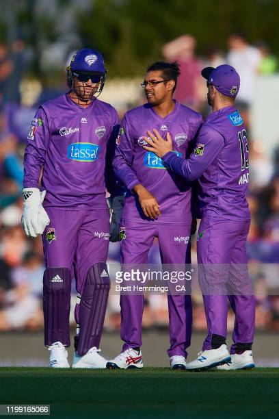 Clive Rose of the Hurricanes celebrates with team mates after taking the wicket of Sam Whiteman of the Scorchers during the Big Bash League match...
