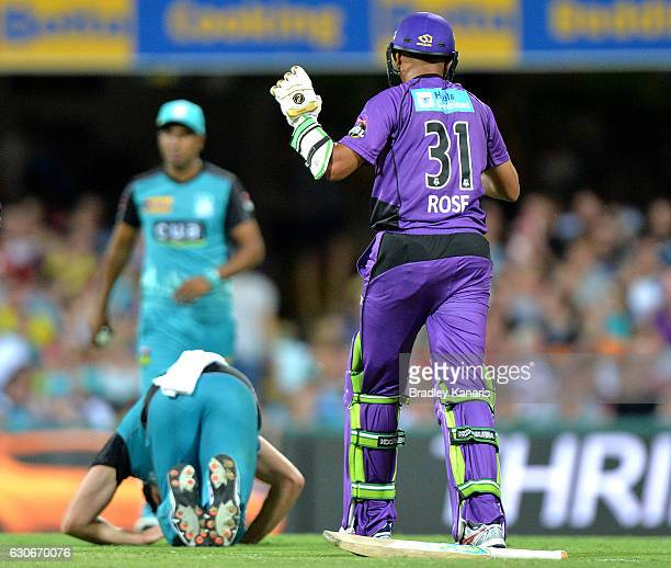 Clive Rose of the Hurricanes checks on Ben Cutting of the Heat after they collide during the Big Bash League between the Brisbane Heat and Hobart...