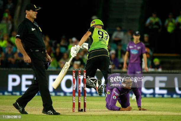 Clive Rose of the Hurricanes fields the ball during the Big Bash League match between the Sydney Thunder and the Hobart Hurricanes at Manuka Oval on...