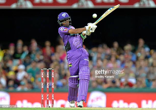 Clive Rose of the Hurricanes hits the ball to the boundary for a four during the Big Bash League between the Brisbane Heat and Hobart Hurricanes at...