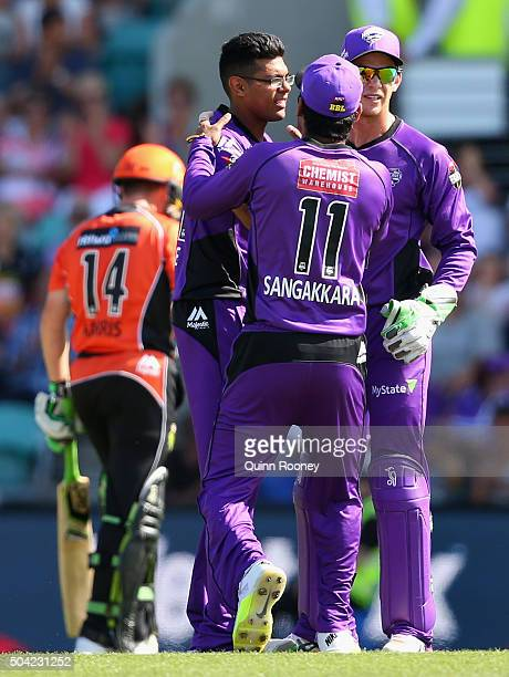 Clive Rose of the Hurricanes is congratulated by team mates after taking the wicket of Marcus Harris of the Scorchers during the Big Bash League...