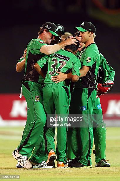 Clive Rose of the Stars is congratulated by his team mates after he bowled the last over of the match during the Big Bash League match between the...