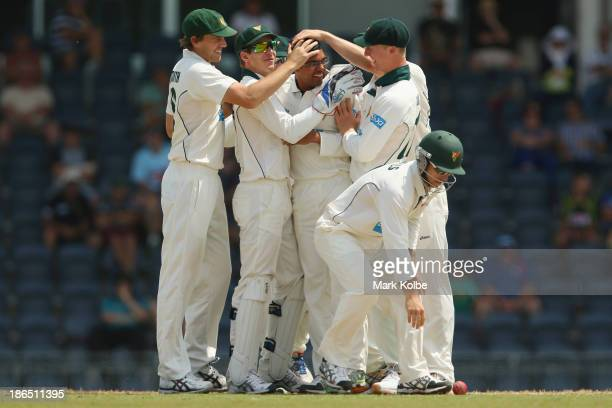 Clive Rose of the Tigers is congratulated by his team mate after taking the wicket of Nic Maddinson of the Blues during day three of the Sheffield...