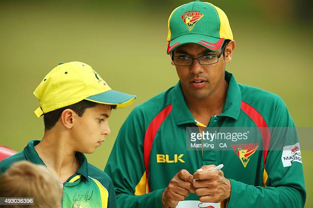 Clive Rose of the Tigers signs autographs for young fans on the boundary during the Matador BBQs One Day Cup match between Tasmania and Western...