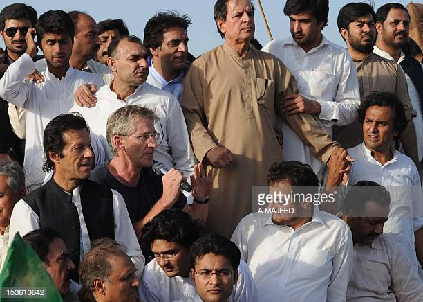Clive Stafford Smith the British head of the legal lobby group Reprieveat is watched by Pakistani politician Imran Khan as he addresses a peace rally...
