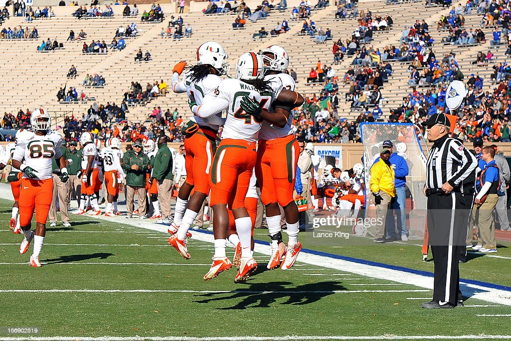 Clive Walford #46 of the Miami Hurricanes celebrates a touchdown with teammates against the Duke Blue Devils at Wallace Wade Stadium on November 24, 2012 in Durham, North Carolina.