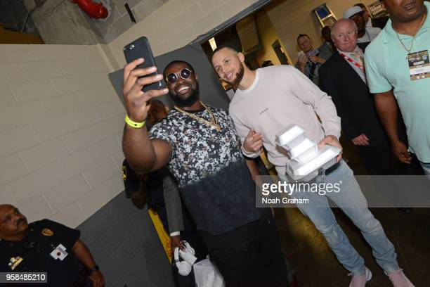 Clive Walford takes a selfie with Stephen Curry of the Golden State Warriors prior to Game Four of the Western Conference Semifinals of the 2018 NBA...