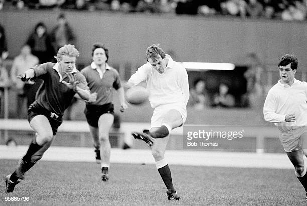 Clive Woodward of England kicks the ball past David Cooke of The Rest during the England v The Rest International Trial match played on the 7th...