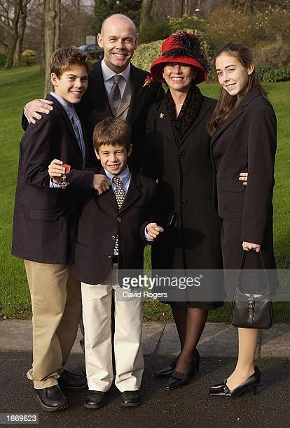 Clive Woodward the England Rugby Union coach poses with his family Freddie Joe wife Jayne and daughter Jessie after being awarded his OBE by Her...