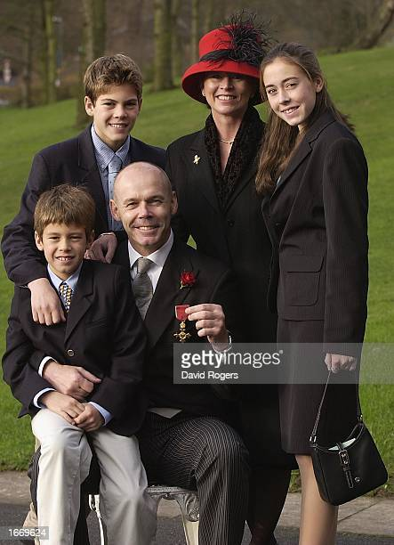 Clive Woodward, the England Rugby Union coach, poses with his family, Freddie , Joe , wife Jayne and daughter Jessie after being awarded his OBE by...
