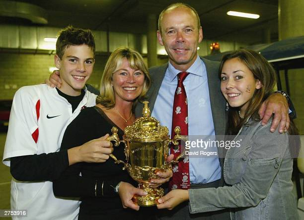 Clive Woodward the Head Coach of England poses for a photograph holding the William Web Ellis trophy with his son Joe wife Jayne and his daughter...