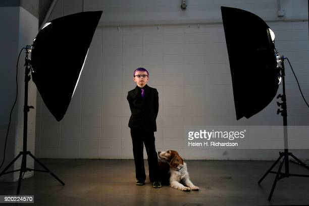 Clive Zickrick of Fort Collins stands for a portrait with his dog Sky a 6 year old Welsh Springer Spaniel during the Colorado Kennel Club Dog Show at...