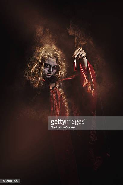 cloaked witch - gothic stock pictures, royalty-free photos & images