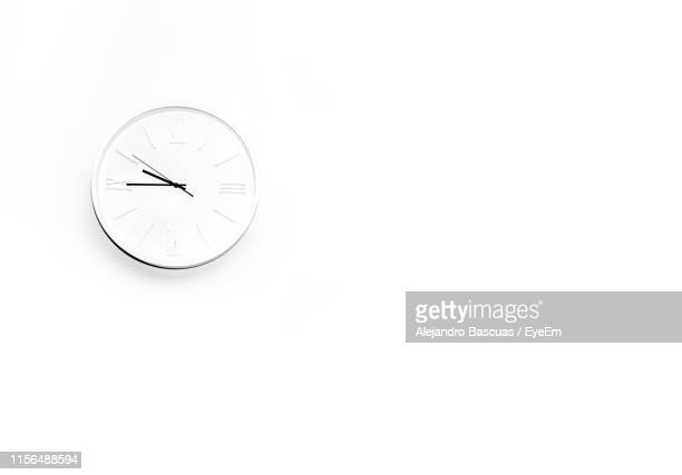 clock against white background - wall clock stock pictures, royalty-free photos & images